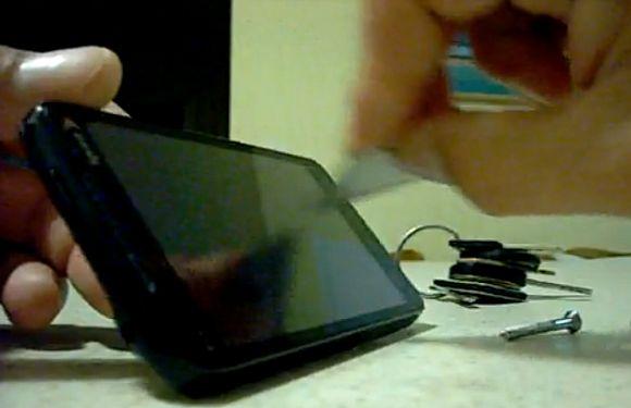 HTC EVO 4G tortured with razor, keys & screws