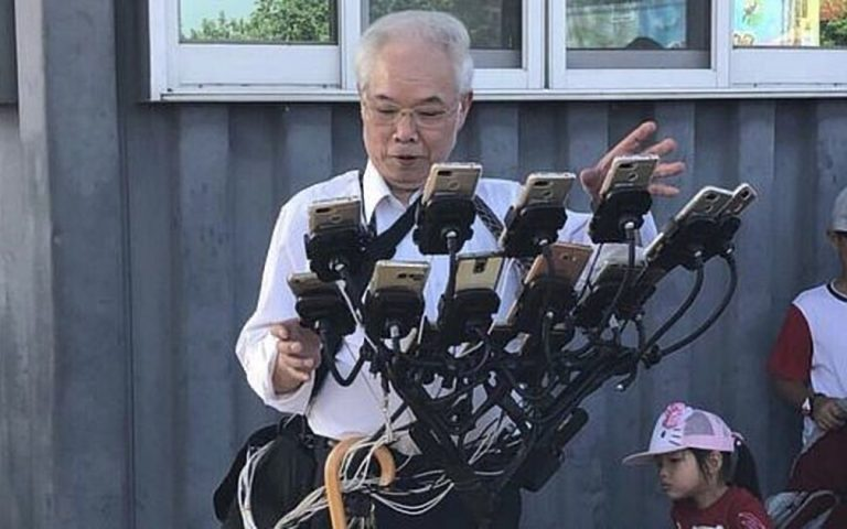 Grandpa uses 12 phones and one epic phone holder to play Pokemon Go